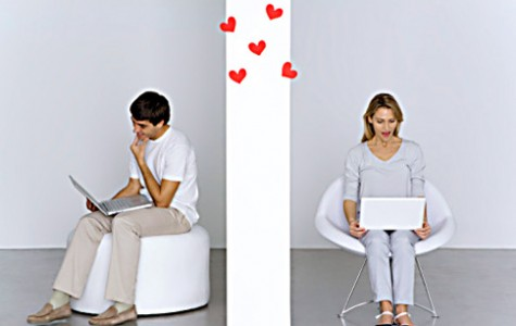 Two people with laptops and hearts