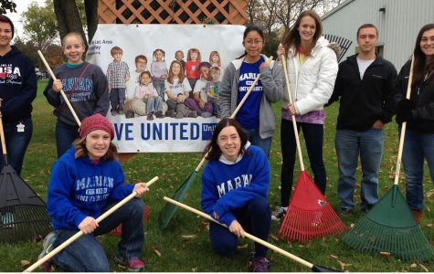 Students raking for United Way