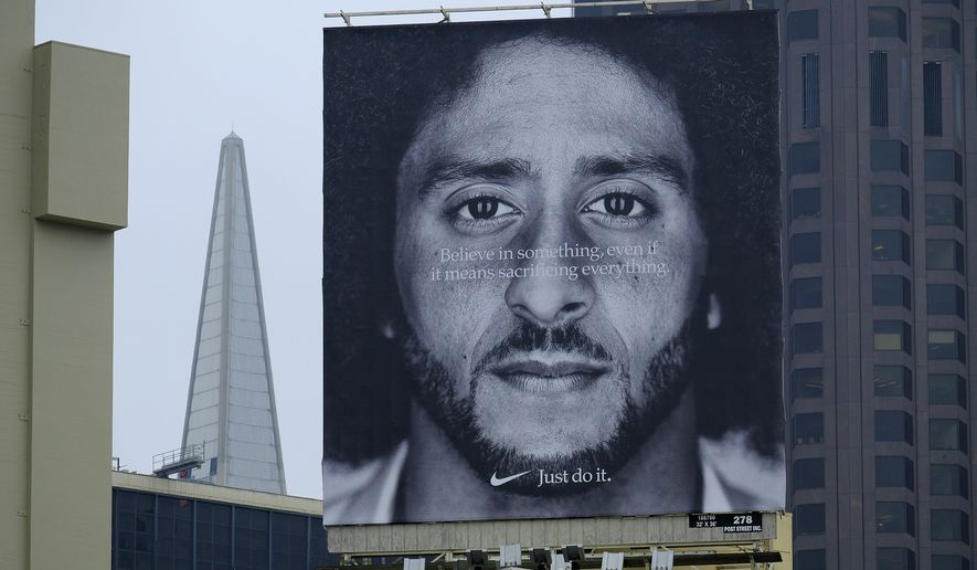 A large billboard stands on top of a Nike store showing former San Francisco 49ers quarterback (Colin Kaepernick).