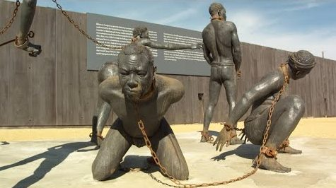Statues of a life as a slave at The National Memorial for Peace and Justice located in Montgomery, Alabama.