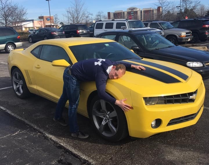 Scott Hansen expressing his love for his yellow Camaro.